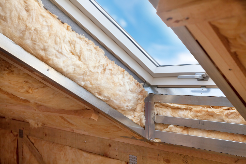 Attic insulation around a skylight
