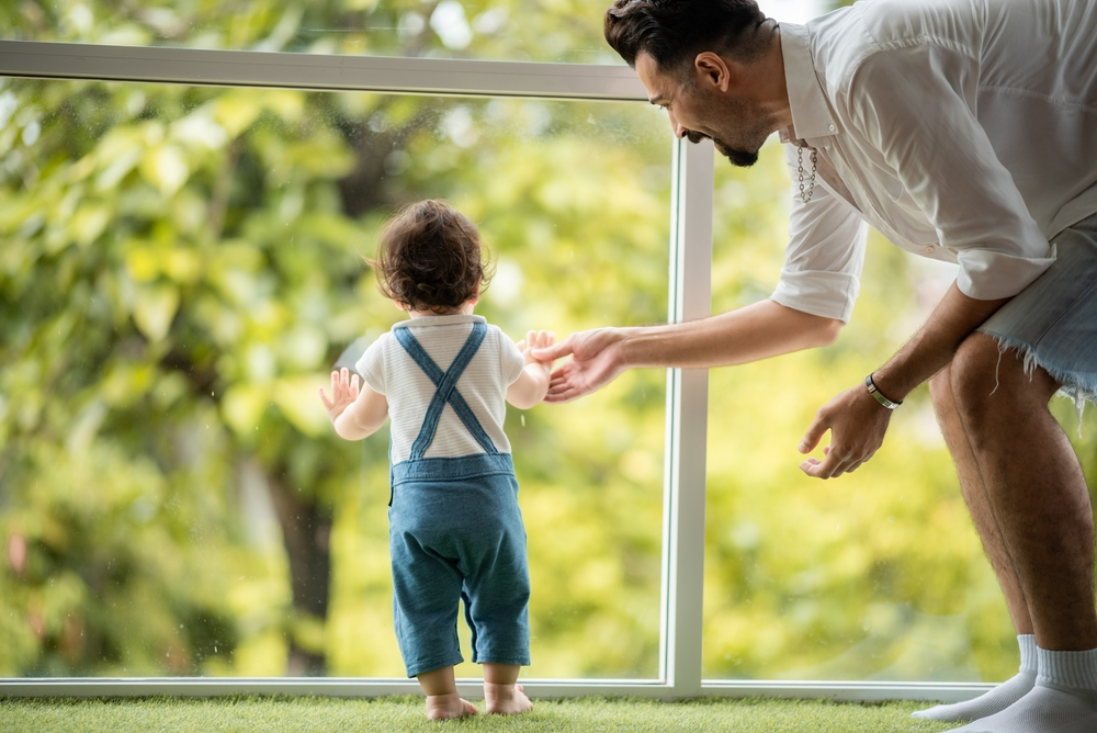 baby learning in first step with support together from father at home